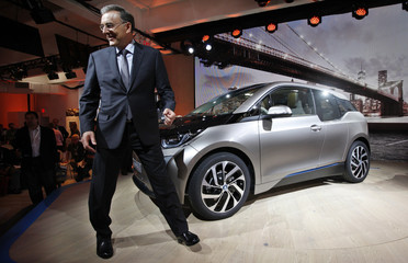 BMW CEO Reithofer walks next to the new BMW i3 all-electric car at an unveiling event in New York