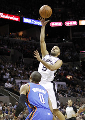 Spurs point guard Tony Parker shoots over Oklahoma City Thunder guard Russell Westbrook in San Antonio