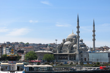 Panoramic of Istanbul: New Mosque (Yeni Cami) from the Bosphorus river. Istanbul, Turkey