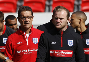 England manager Fabio Capello and Wayne Rooney attend a team training session at Wembley Stadium