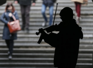 A busker plays the violin in an underpass in central Kiev