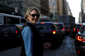 Actress Greta Gerwig poses for photos on the street after attending the Calvin Klein Autumn/Winter 2017 collection presentation during New York Fashion Week