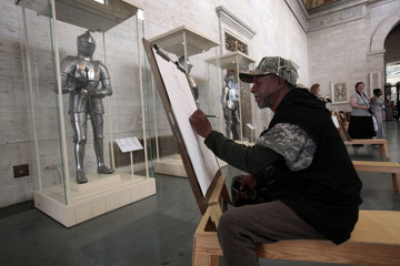 Detroit resident Larry Armstrong, 60, participates in the free drawing in the art galleries at the Detroit Institute of Arts in Detroit