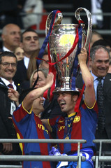 Barcelona's Villa and Pedro celebrate with the trophy after their Champions League final soccer match against Manchester United at Wembley Stadium in London