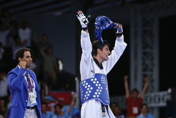 Taghizade of Azerbaijan celebrates after winning his men's 68Kg taekwondo gold medal fight against Karol Robak of Poland at the 1st European Games in Baku
