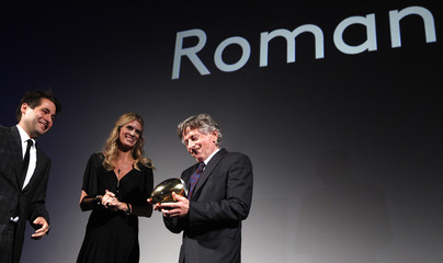 Director Polanski reacts next to Festival Directors Spoerri and Schildknecht after receiving his lifetime achievement award at the Zurich Film Festival