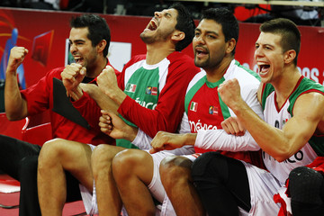 Mexico's players celebrate after defeating Argentina during their 2013 FIBA Americas Championship semi-final basketball game in Caracas