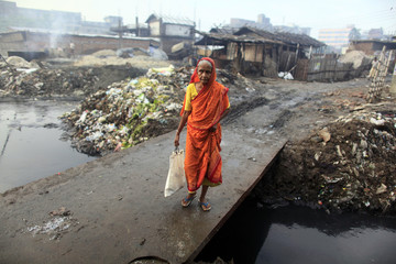 A woman crosses a bridge next to a tannery factory by the river Buriganga at Hazaribagh in Dhaka.