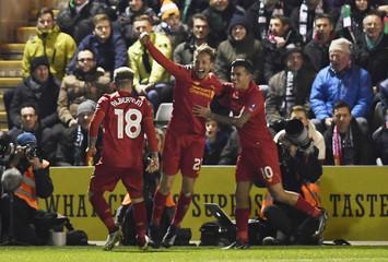 Liverpool's Lucas Leiva celebrates scoring their first goal with team mates