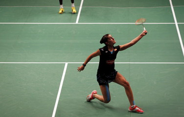 Spain's Carolina Marin hits a return to Korea's Sung Ji-hyun during their semi-final women's singles badminton match at the BWF World Championship in Jakarta, Indonesia