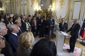 French Prime Minister Jean-Marc Ayrault delivers a speech during a new year ceremony attended by President Francois Hollande and members of the government at the Elysee Palace in Paris