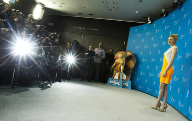 "Stone, voice of character Eep, poses during photocall promoting animation movie ""The Croods"" at Berlinale International Film Festival in Berlin"
