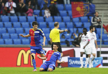 FC Basel's Schaer celebrates with Stocker after scoring a goal against FC Servette during their Swiss Super League soccer match in Basel
