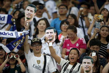 Fans of Real Madrid reacts during a training session ahead of a friendly match against A.C. Milan in Shanghai