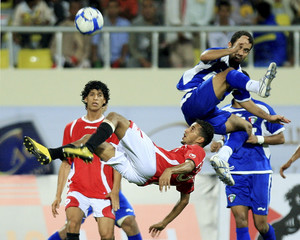 Kuwait's Talal Al Amer fights for the ball with Yemen's Zaher Al Fadli during the Gulf Cup soccer match in Abyan