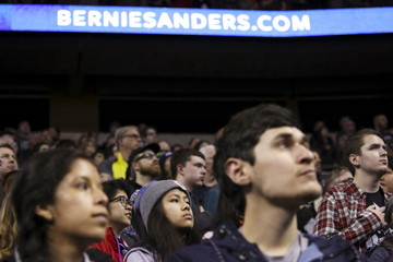 Supporters of Democratic U.S. presidential candidate Bernie Sanders listen to The Star Spangled Banner during a Sanders rally at Key Arena in Seattle, Washington