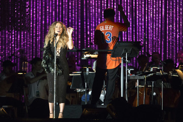 Singer Carey wears a sling while performing with the New York Philharmonic at the MLB All-Star Charity Concert benefiting Sandy Relief in New York