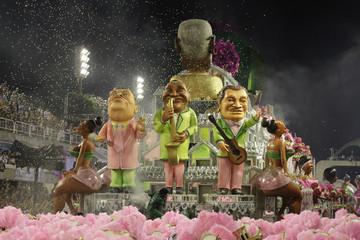 Revellers of the Mangueira samba school participate in the second night of the Carnival parade in Rio de Janeiro's Sambadrome