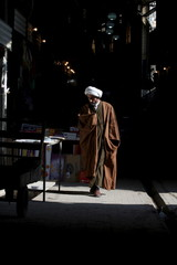 A Shiite cleric walks to a religious school called (Hawza Ilmiyya) where Shiite Muslim clerics are trained in Najaf