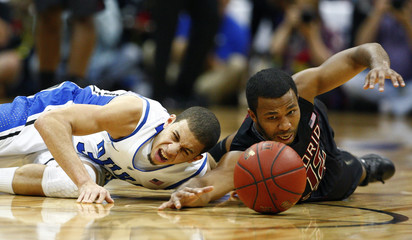 Duke Blue Devils Seth Curry fights for a loose ball against Florida State Seminoles Jeff Peterson during their ACC college basketball tournament game in Atlanta