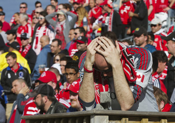 A Toronto FC fan reacts to his teams performance as they lose to the DC United during the second half of their MLS soccer match in Toronto