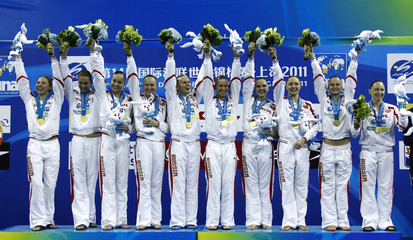Russia's team celebrate with their gold medals for the synchronised swimming teams technical final at the 14th FINA World Championships in Shanghai