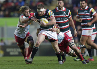 Brendon O'Connor of Leicester Tigers tackled by Luke Wallace and James Horwill of Harlequins