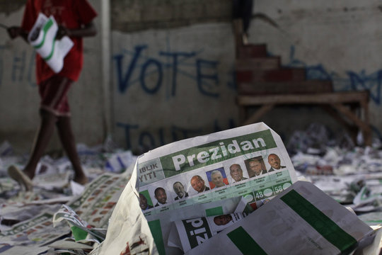 Presidential and legislative ballots are seen lying on the floor after angry voters trashed the voting center on Sunday in Port-au-Prince