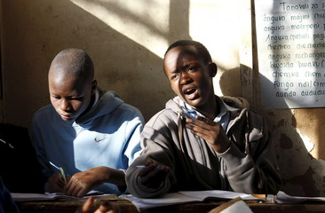 Pupils revise their class work without a teacher during a strike, at Olympic Primary School in Nairobi