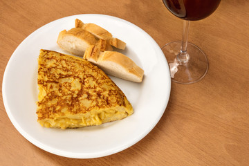 Spanish tortilla with wine, tapas in a bar
