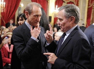 Speaker of France's national Assembly Accoyer talks to Paris'mayor Delanoe at the Elysee Palace in Paris