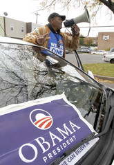 Supporter of President Barack Obama, Armour delivers message during U.S. presidential election with bullhorn near Penrose recreation center polling place in Philadelphia