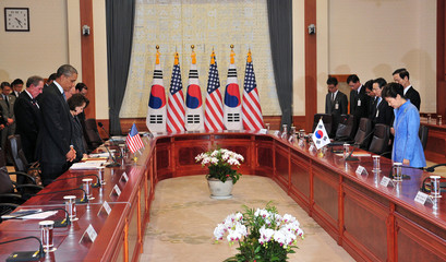 U.S. President Obama and South Korean President Park pay silent tribute for victims of South Korea's sunken ferry Sewol, during their meeting at the presidential Blue House in Seoul