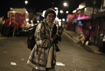 A homeless man walks after receiving food during an event held to celebrate Christmas with the homeless in San Jose