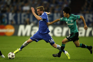 Chelsea's Schuerrle is challenged by Schalke 04's Uchida during their Champions League soccer match in Gelsenkirchen