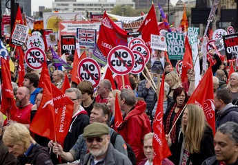Demonstrators carry placards during a protest march in central London