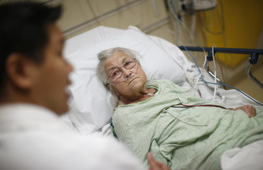 Patient Bush receives treatment from Doctor Yeh in the Emergency Room at OSF Saint Francis Medical Center in Peoria