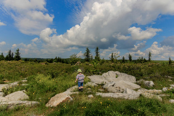 Toddler exploring rugged country.