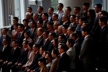 Lawmakers pose for an official group photo at the Legislative Council in Hong Kong