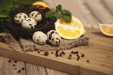 Quail eggs - Quail eggs in a ceramic bowl on old brown wooden surface background, selective focus. Top view.