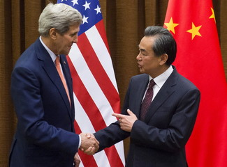 Chinese Foreign Minister Wang Yi and U.S. Secretary of State John Kerry shake hands prior to meetings at the Ministry of Foreign Affairs in Beijing