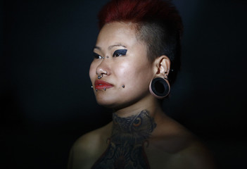 """Gurung, the first woman from Nepal to perform a body suspension, poses for a picture during the """"Nepal Inked - A Tattoo and Lifestyle Convention"""" in Kathmandu"""