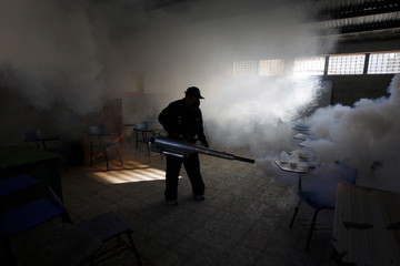 Municipal health worker fumigates a classroom as part of the city's efforts to prevent the spread of the Zika virus vector, the Aedes aegypti mosquito, at the Nueva Suyapa neighbourhood in Tegucigalpa