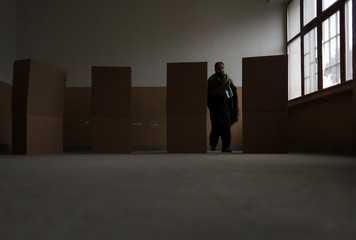 Man walks from a voting booth after filling out his ballot paper at a polling station in Kabul
