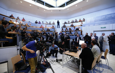 Director of Lausanne University Hospital's forenics centre Magnin and Director of its Institute of Radiation Physics Bochud hold news conference in Lausanne