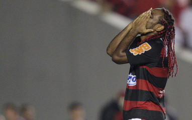 Brazil's Flamengo's Vagner Love reacts during their Copa Libertadores soccer match against Venezuela's Caracas