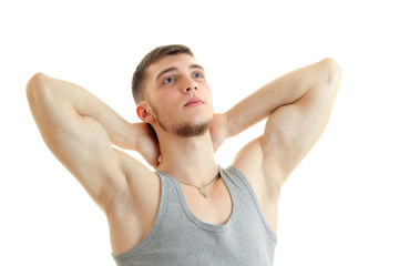 young strong guy with the session you muscles raised hands behind the neck and looking up isolated on a white background