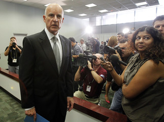 California Attorney General and Democratic candidate for Governor Jerry Brown answers reporters' questions following a news conference in Los Angeles