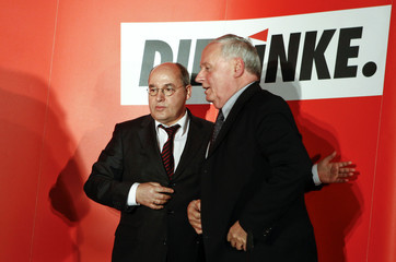 Co-party leader Lafontaine  of the left-wing party Die Linke is accompanied by party fellow Gysi after they addressed a news conference in Berlin
