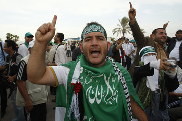 An International peace activist gestures upon his arrival at the Rafah border crossing